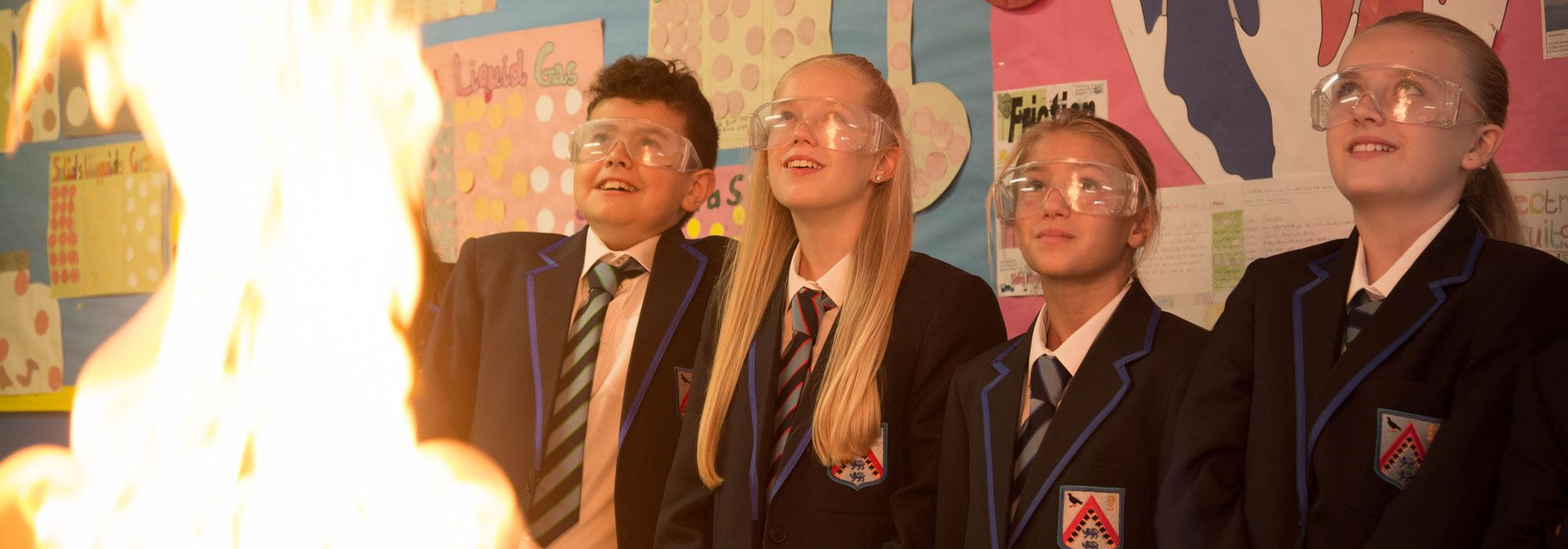 Science class with pupils watching flammable chemicals