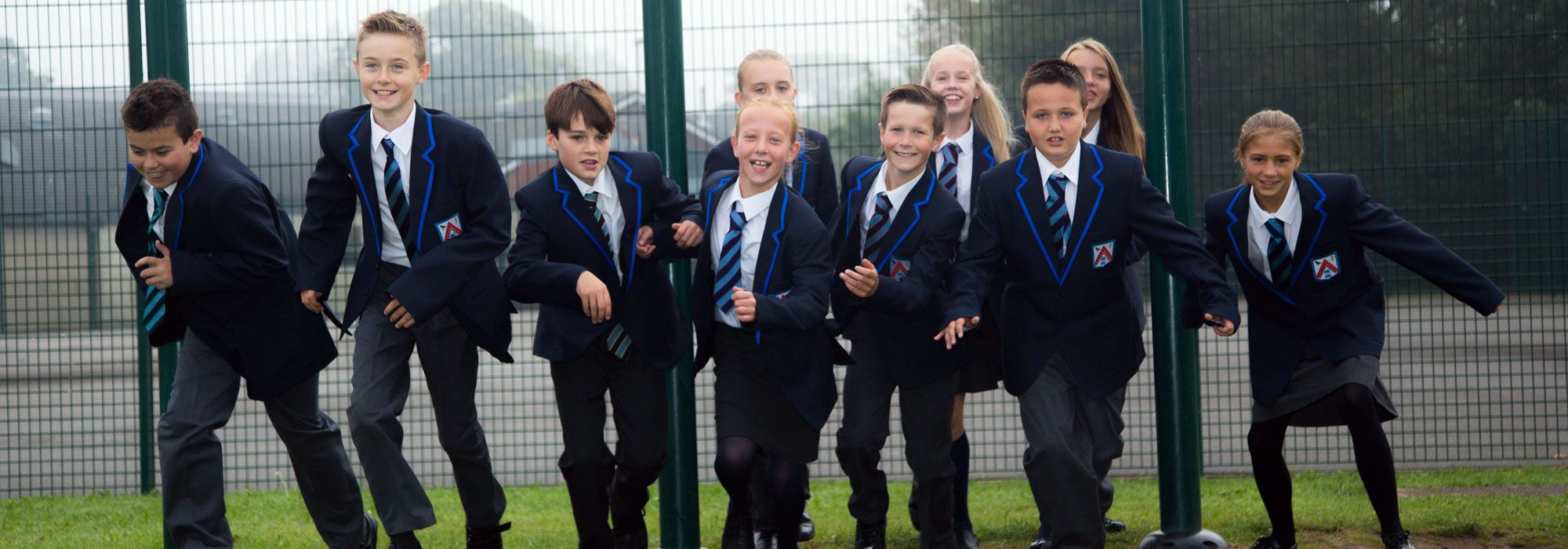 Pupils playing outdoors at The Maelor School
