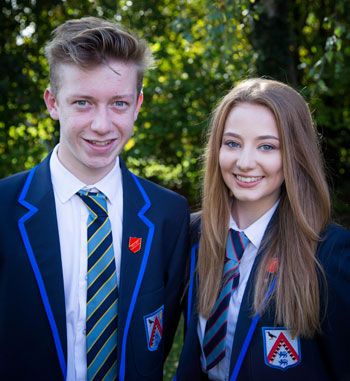 Male and female pupils in school uniform at The Maelor School